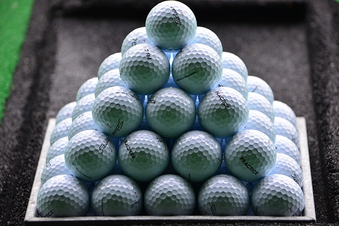 A perfect pyramid of Pro V1x practice balls.