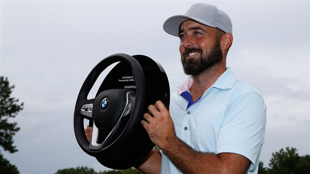 Rhein Gibson raises the winner's trophy at the Web.com TOur's BMW Charity Pro-Am