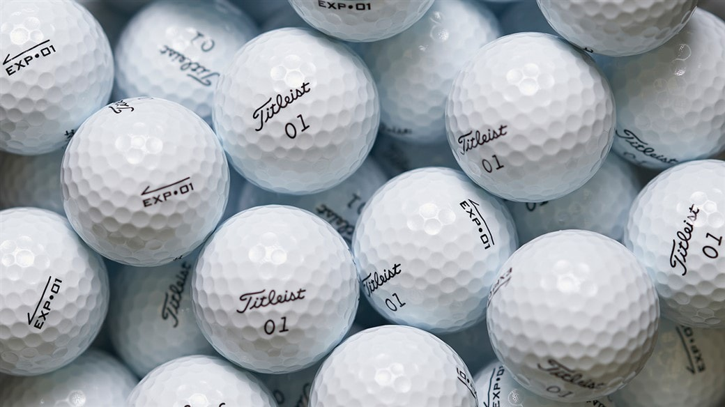 Photo of multiple EXP•01 golf balls, ready for packaging.