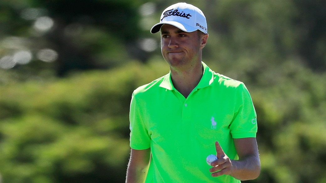 Justin THomas salutes the crod with his Pro V1x golf ball after holing a birdie putt during action on the PGA TOUR in 2019