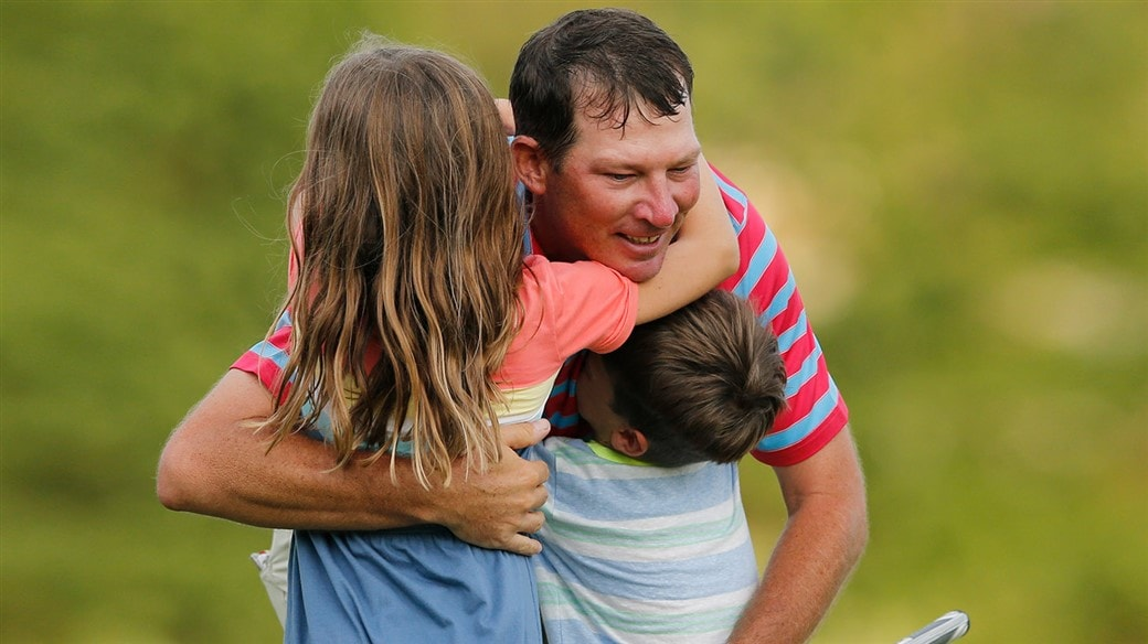 Jim Herman hugs his daughter, Abigail, and son, Andrew, after winning the 2019 Barbasol CHampionship.