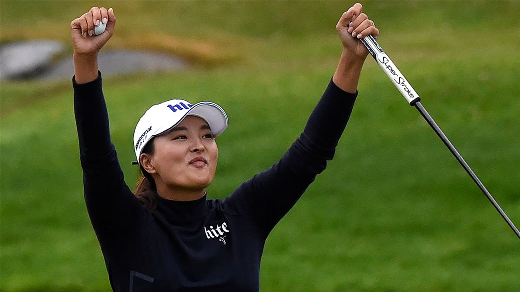 Jin Young Ko raises her arms in triumph after holing the winning putt at the 2019 Evian Championship