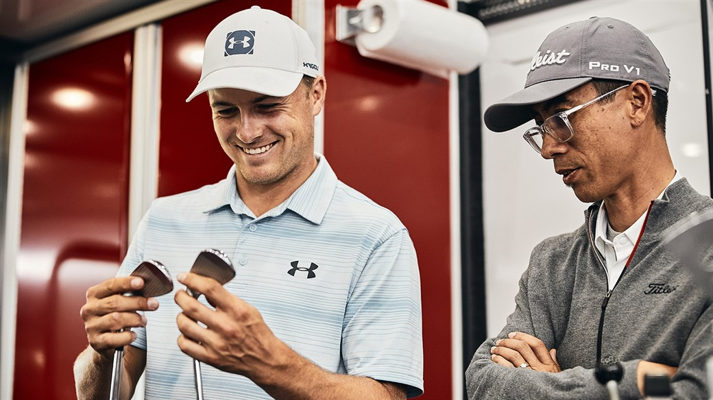 Jordan Spieth gets his first look at new Titleist T100 irons and learns about the new design from Marni Ines, Titleist Director of Iron Development