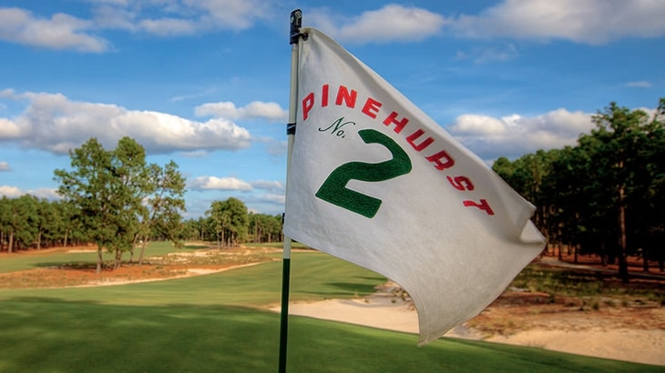 A pin flag on the green at Pinehurst No. 2