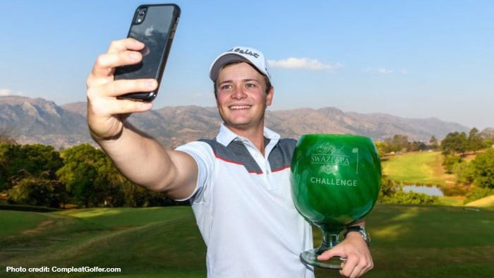 Ruan Conradie takes a selfie with trophy from maiden victory.