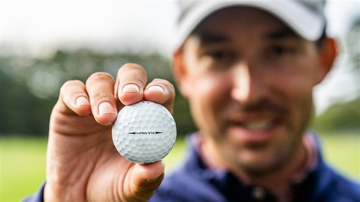 Golfer Raising a Pro V1x Left Dash Golf Ball