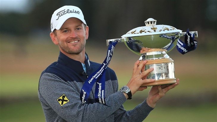 Bernd Wiesberger raises the trophy after capturing the 2019 Scottish Open.